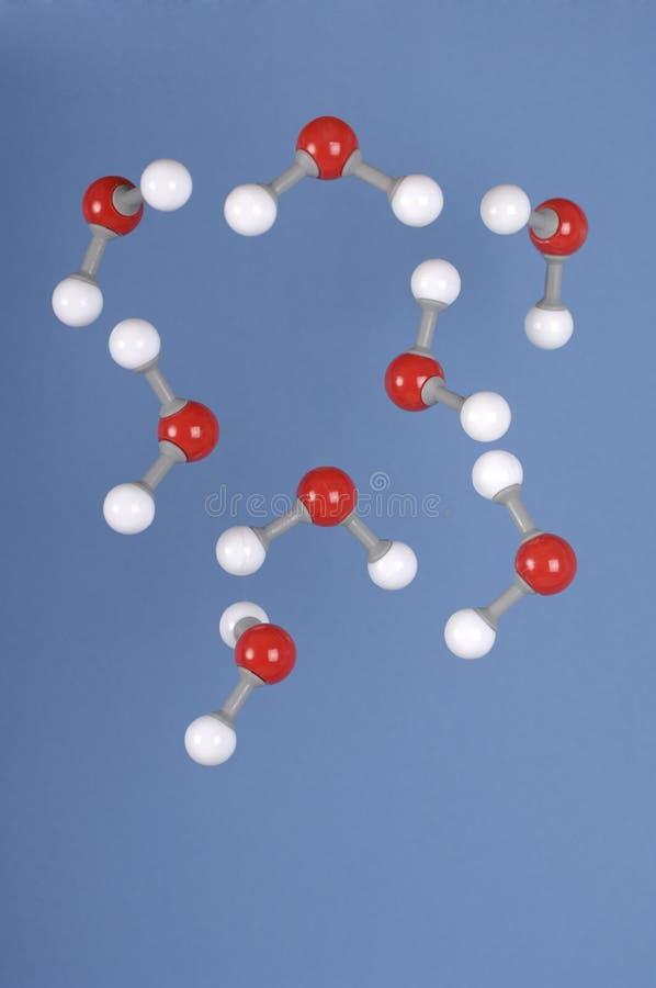 fallande h2o-molekylvatten arkivfoto
