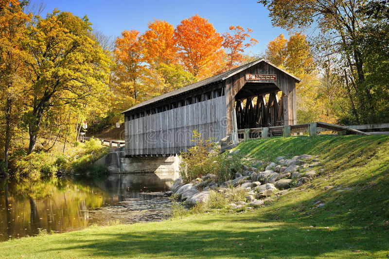 Fallasburg Covered Bridge Lowell Mi,USA. Autumn blaze at Michigan's Fallasburg Covered Bridge. Fallasburg Historic Village, USA royalty free stock photo