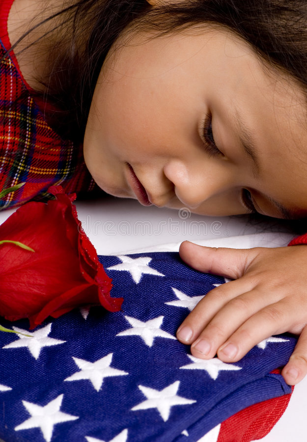 Fallen. A young girl grives for her fallen hero stock photo