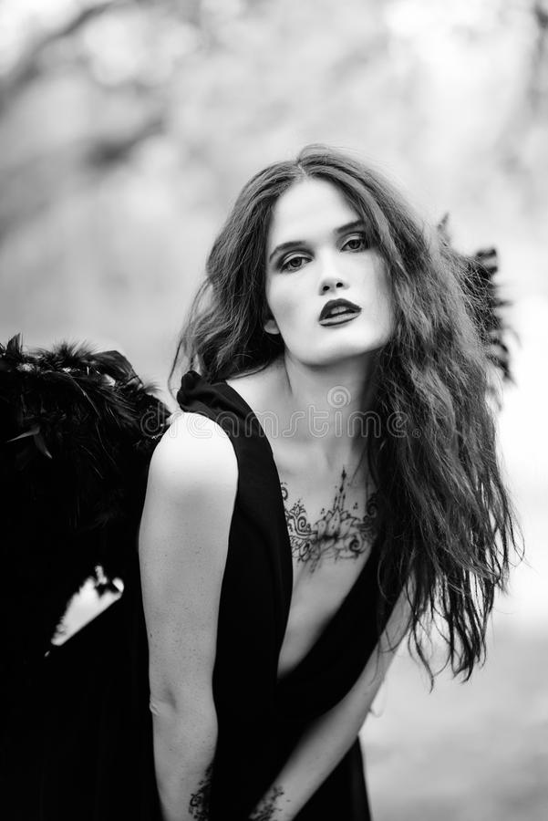 Fallen angel with black wings royalty free stock photo