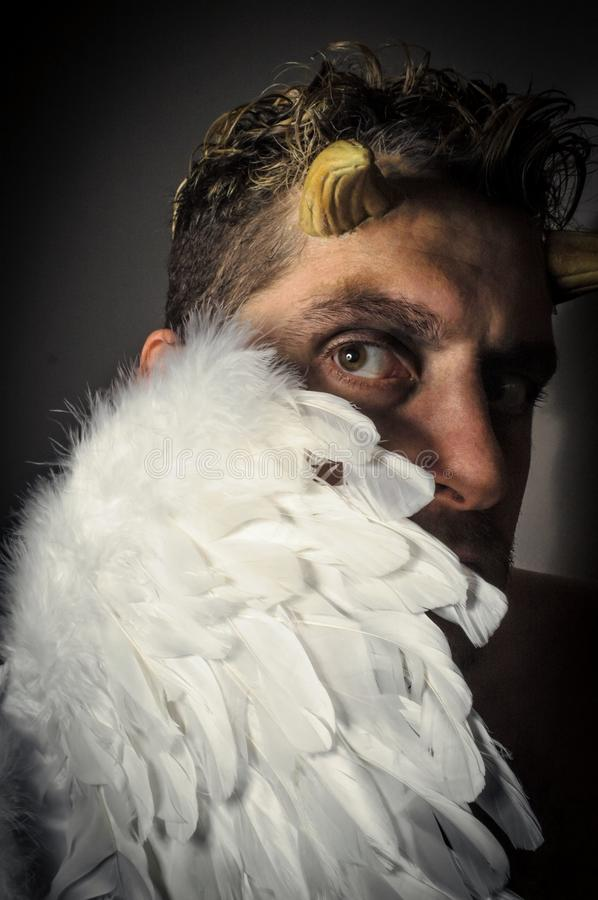 Fallen Angel Demon. Fallen angel satan with feathered wings and moody lighting stock photography
