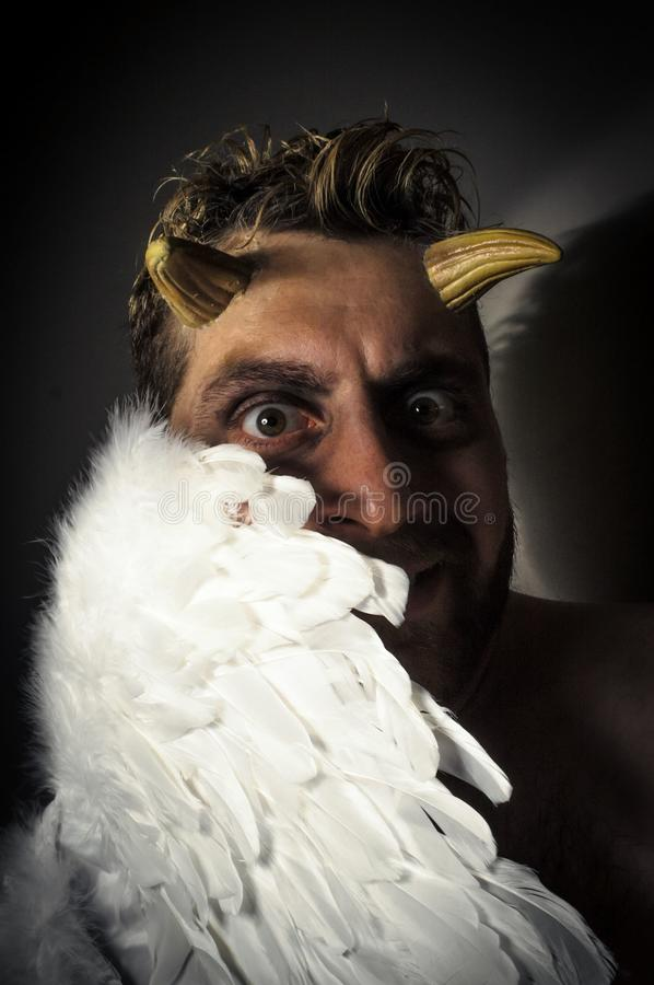 Fallen Angel Demon. Fallen angel satan with feathered wings and moody lighting stock photos