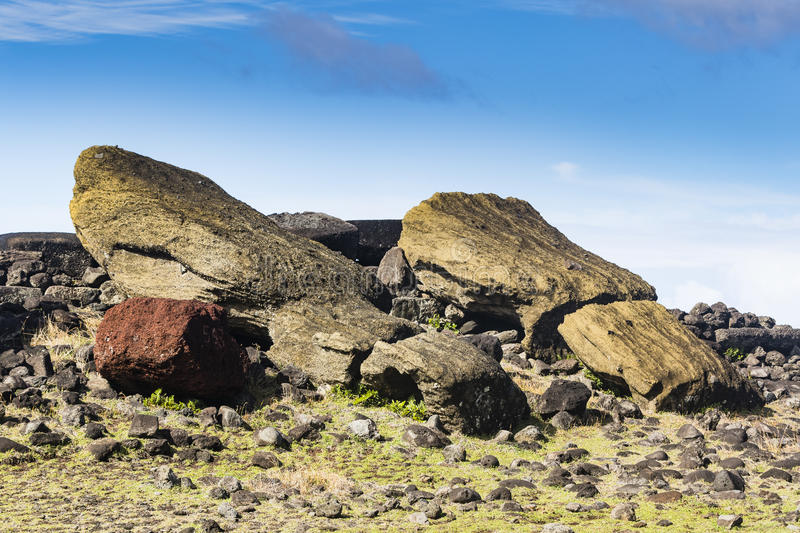 Fallen and broken Moai statues royalty free stock photography
