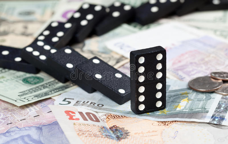 Download Fallen Dominoes On Bank Notes Stock Photo - Image: 22711354