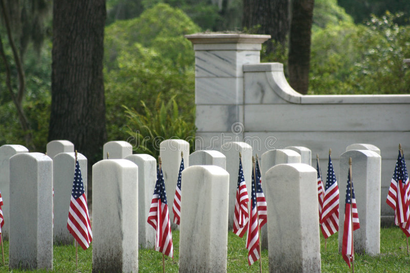 Fallen Heroes. Photo of gravestones of fallen soldiers with flags at each grave stock photos