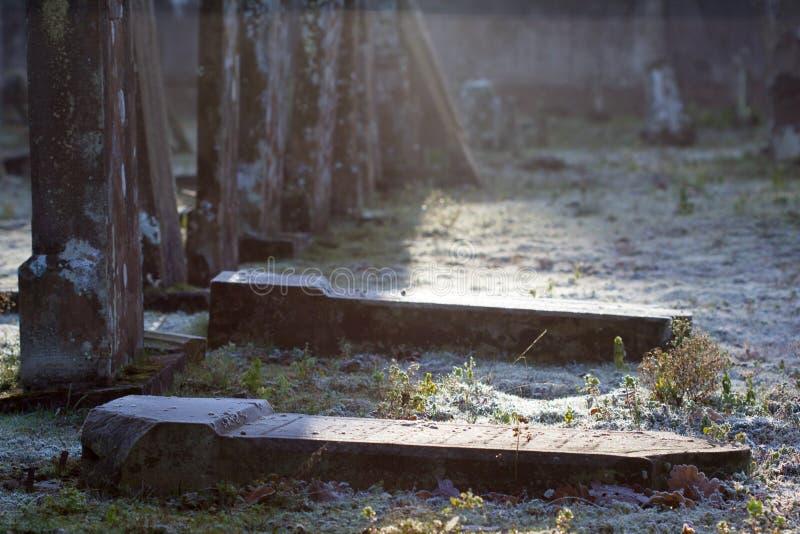 Fallen tombstones stock photography
