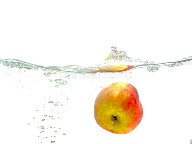 Fallender Apfel stockbilder