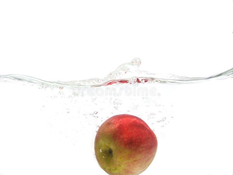 Fallender Apfel lizenzfreies stockfoto