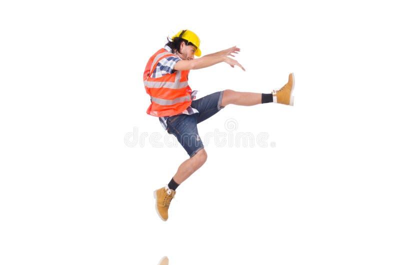 Fallender junger Bauarbeiter an lokalisiert lizenzfreie stockbilder