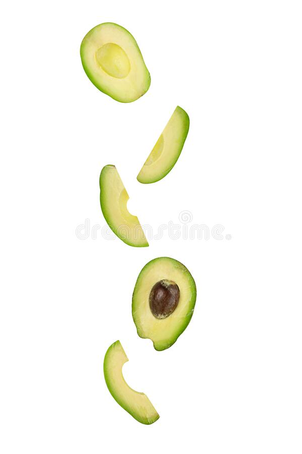 Falling avocado isolated on white background with clipping path as package design element and advertising. Flying foods. Floating, hanging fruits in the air stock images