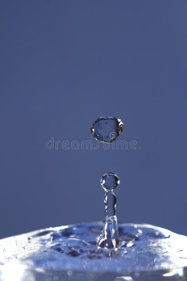 Falling blob - frozen motion. Close-up od the spout - abstract shot of the water stock photos