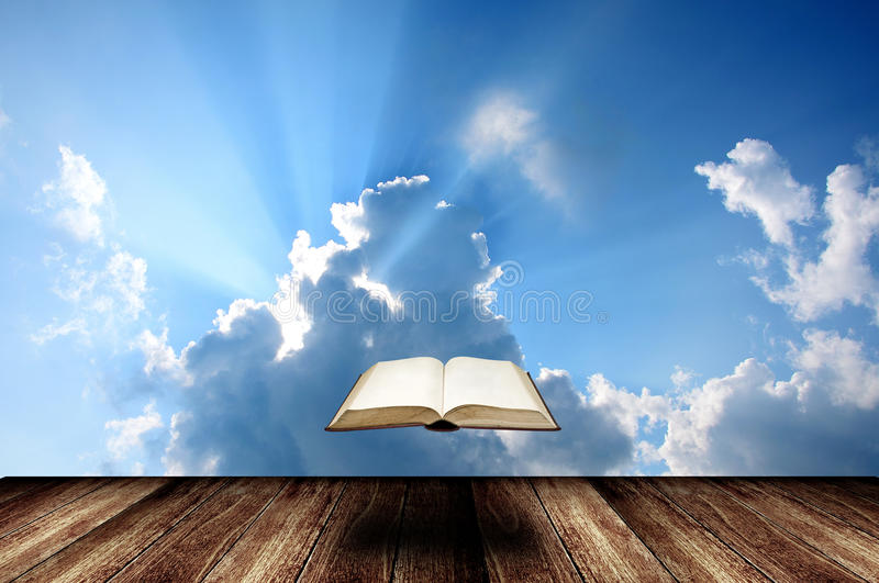Falling book from the sky stock images