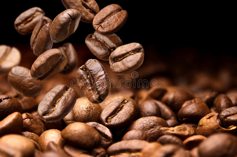 Falling coffee beans. Dark background with copy space stock photo