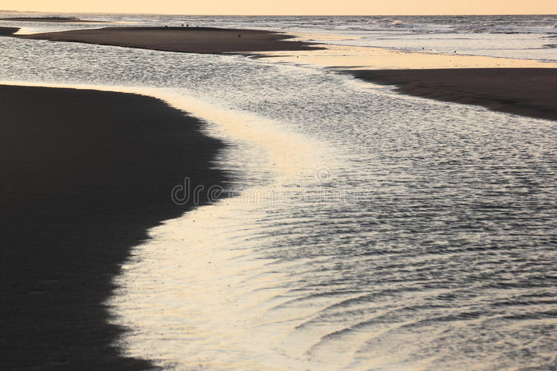 Falling darkness at Ameland beach, the Netherlands stock photography
