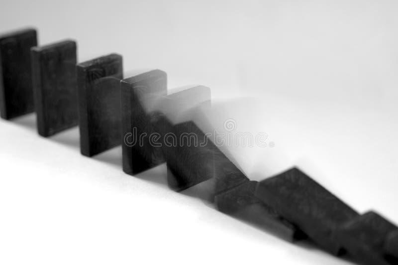Falling dominos 1 stock image