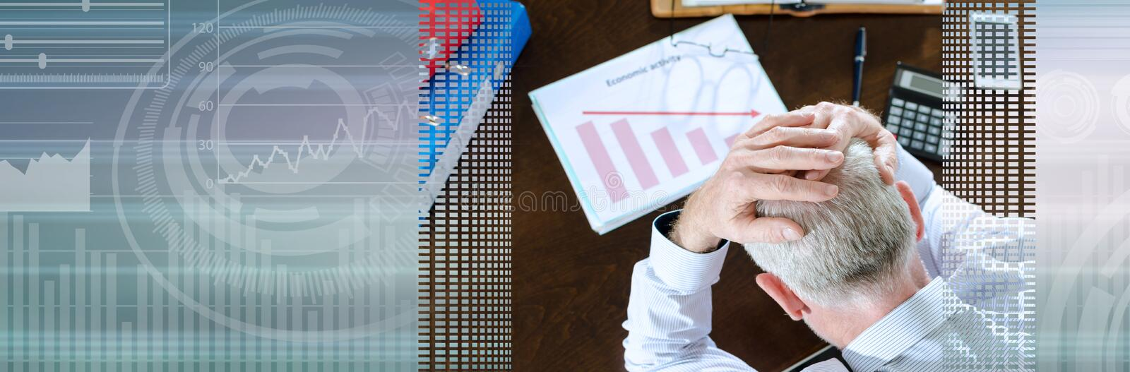 Falling down of economic activity; panoramic banner. Despairing businessman because of the economic crisis; panoramic banner royalty free stock images