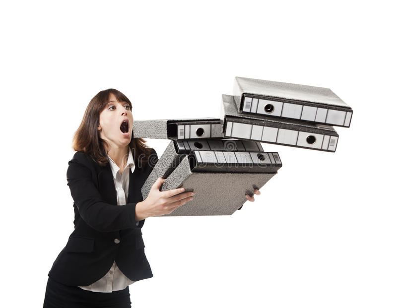 Falling folders. Woman in the office stumbling with a pile of folders in the hands, isolated on white stock photography