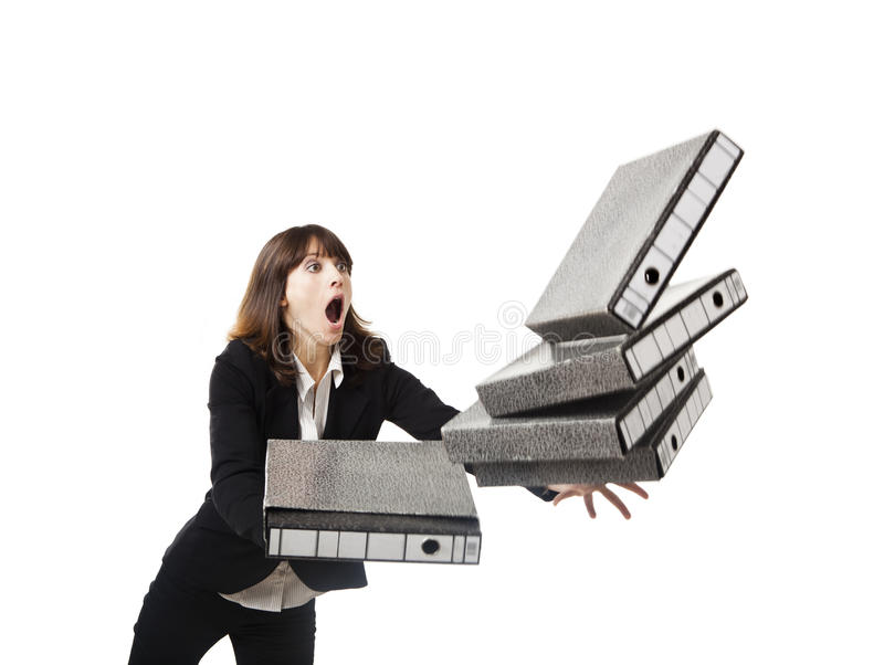Falling folders. Woman in the office stumbling with a pile of folders in the hands, isolated on white stock images