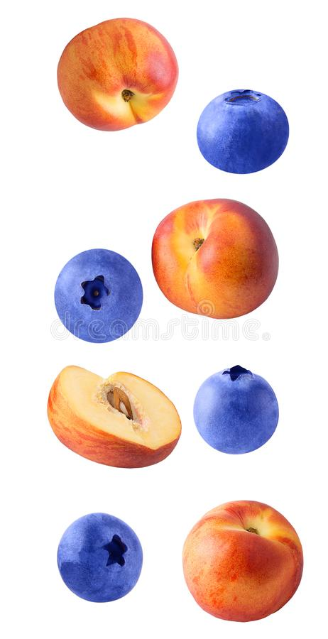 Falling fresh berriy and peaches isolated on white background royalty free stock image