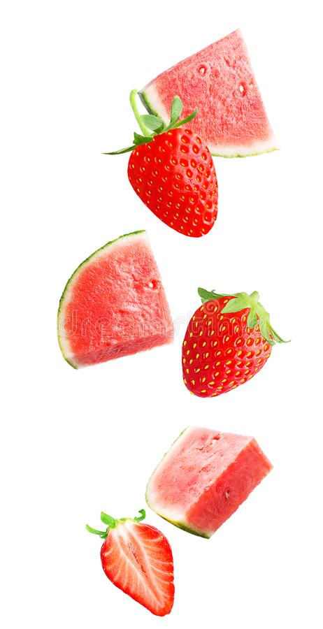 Falling fresh berry and watermelon isolated on white background royalty free stock photo