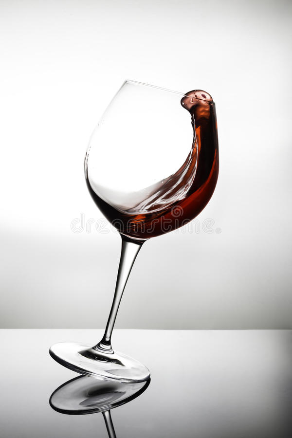 Falling glass of wine royalty free stock image