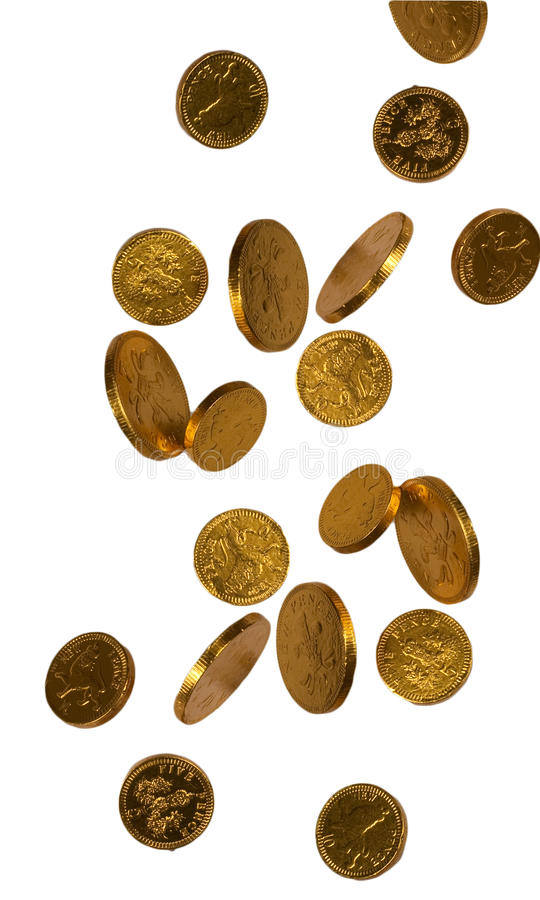 Falling gold chocolate coins stock images