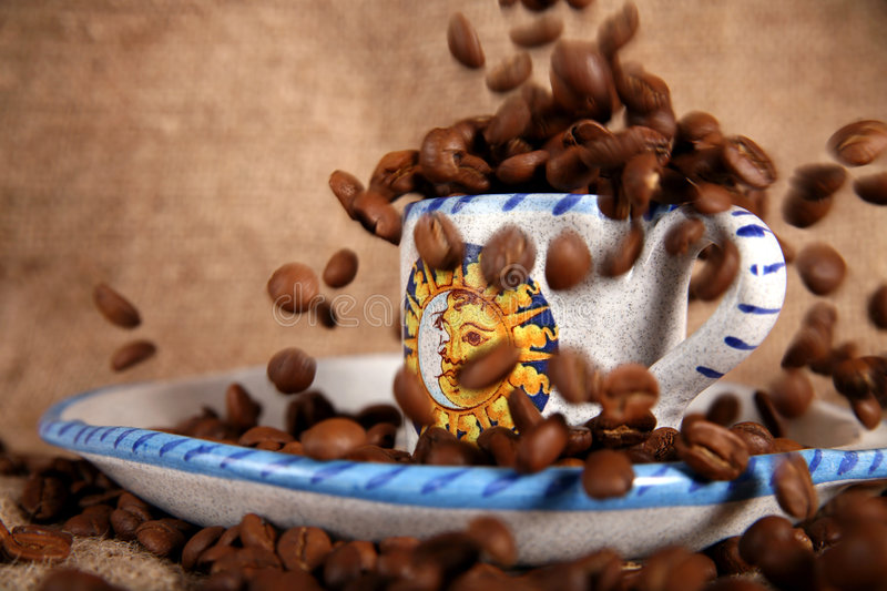Falling grains of coffee stock photography