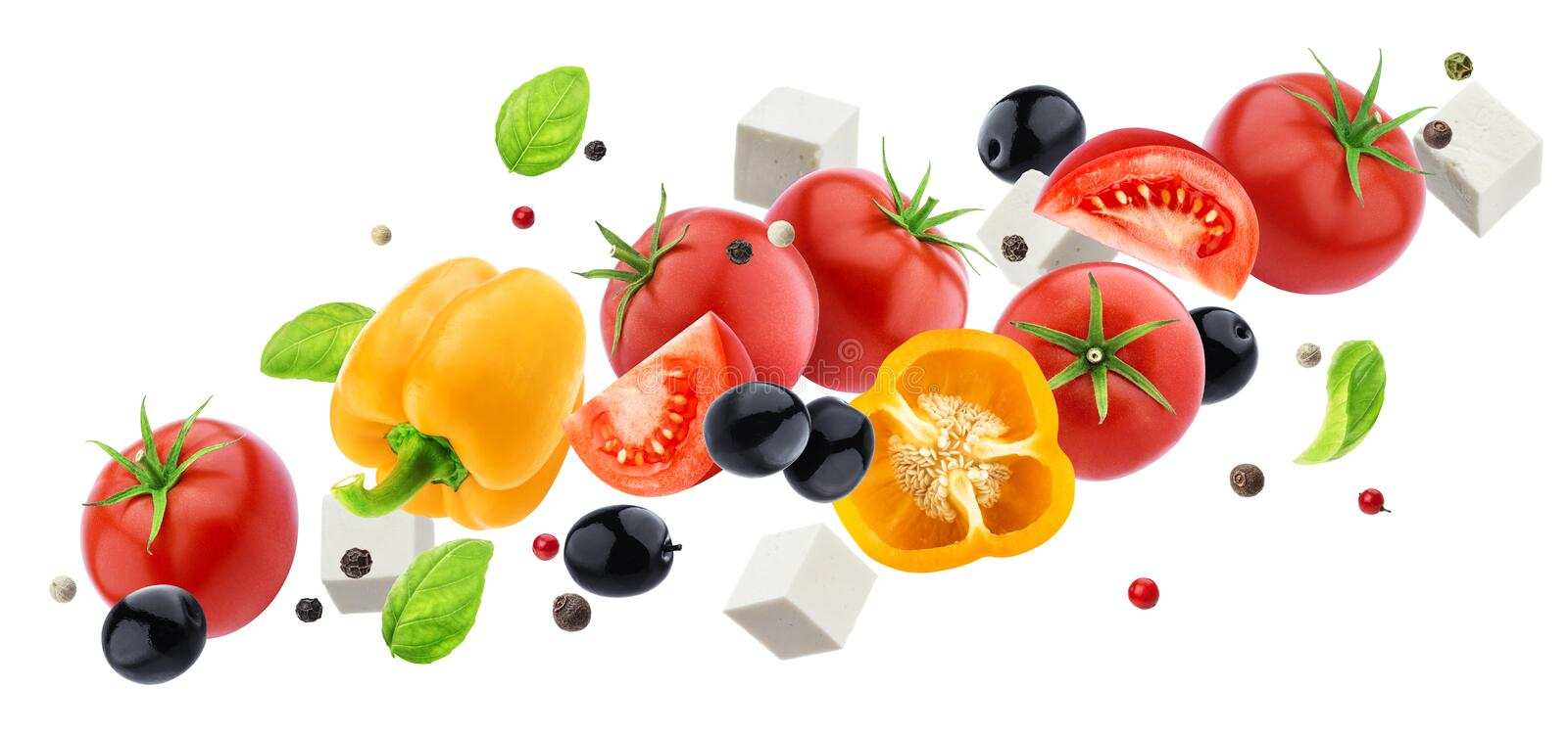 Falling greek salad isolated on white background with clipping path, flying fresh vegetable salad ingredient. S: feta cheese, tomato, cucumber, olives, basil and royalty free stock images