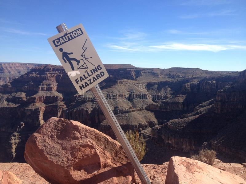 Falling Hazard Sign, The Grand Canyon. A steep-sided canyon carved by the Colorado River in Arizona, United States. The Grand Canyon is 277 miles 446 km long, up stock photo