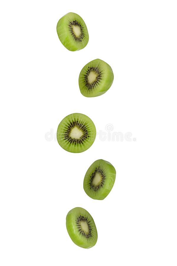 Falling kiwi isolated on white background with clipping path as package design element and advertising. Flying foods. Floating, hanging fruits in the air. Copy stock photography
