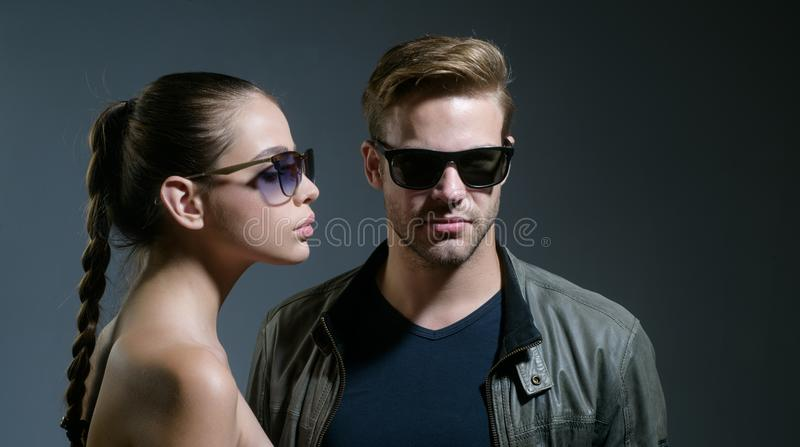 Falling in love with my sunnies. Friendship day. Fashion models in trendy sun glasses. Couple in love. Couple wear. Fashion glasses. Love relations. Friendship stock image