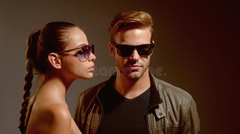 Falling in love with my sunnies. Friendship day. Fashion models in trendy sun glasses. Couple in love. Couple wear. Fashion glasses. Love relations. Friendship stock images