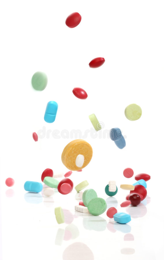 Falling medicine pills. From my pharmacy series royalty free stock image
