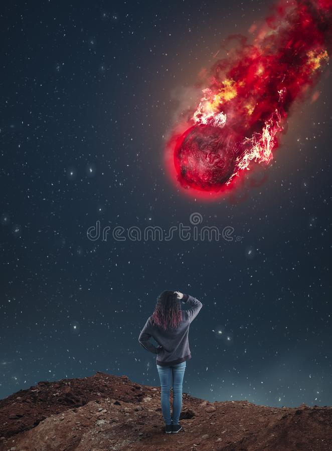 Falling meteor during night. Confused woman looking up to a falling meteorite during night stock photos
