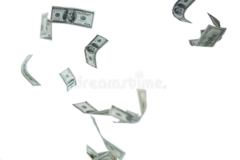Falling one hundred dollar bills. Against white background royalty free stock photo