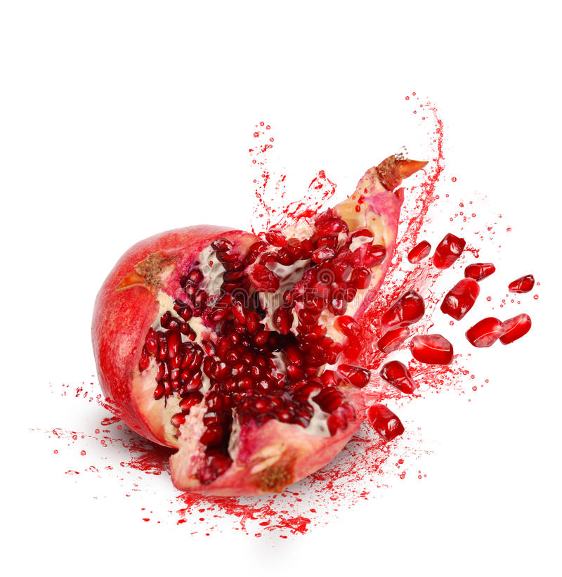Falling pomegranate with splashes of juice stock photos