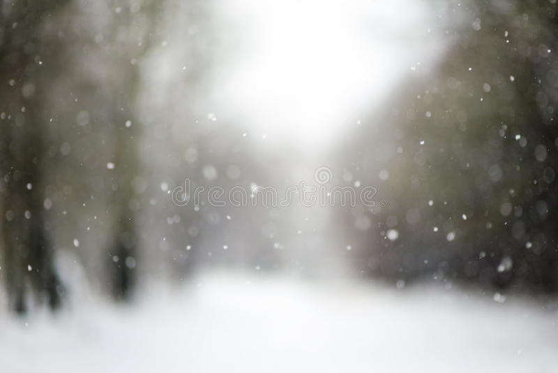 Falling snow, blurred Christmas texture royalty free stock photography