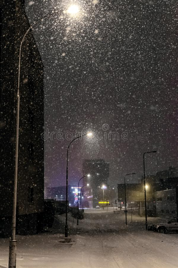 Falling snow in the city at night. Vilnius, Lithuania royalty free stock photography