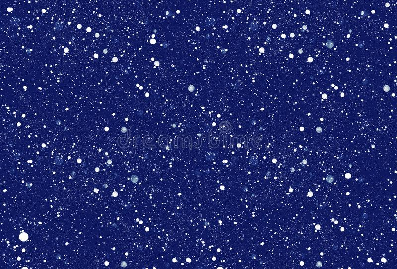 Falling snowflakes on dark blue background royalty free stock image