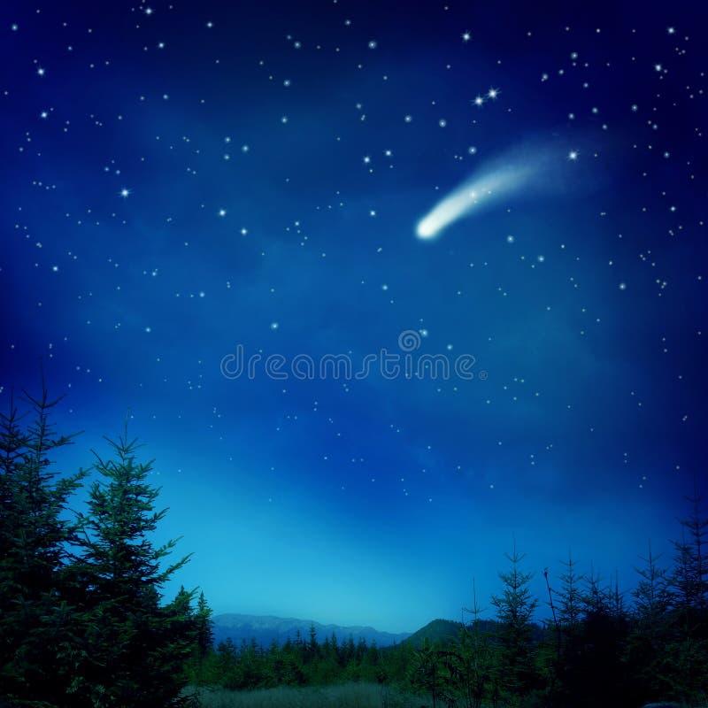Falling star. At dark night stock photo