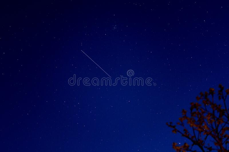 Shooting star in the sky royalty free stock photo