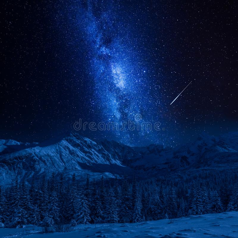 Falling star and Tatras Mountains in winter at night, Poland royalty free stock photo