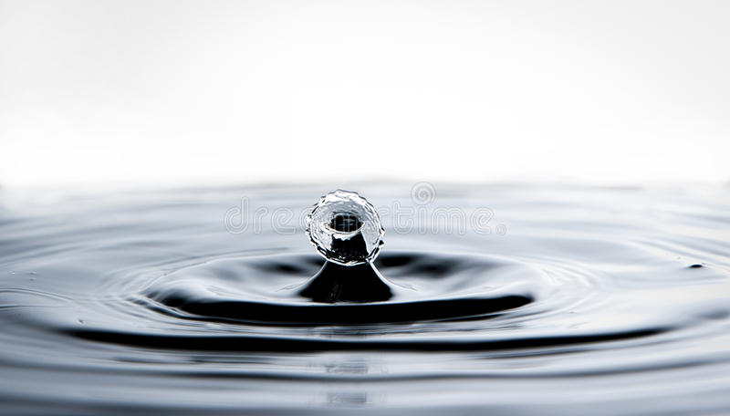 Falling water drop royalty free stock photo