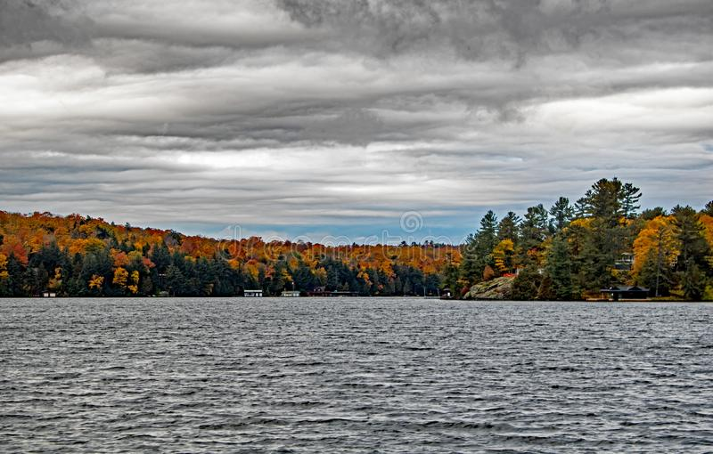 Falls Colors And Ominous Clouds On Lake Rosseau stock photos