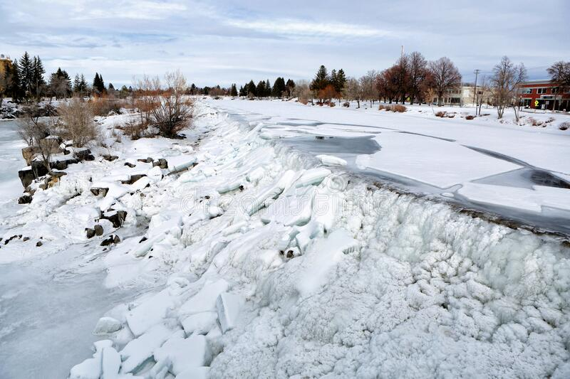 Ice on the waterfall that the City of Idaho Falls, Idaho is named after. The falls freezes on a cold winter day and ice sheets back up on the waterfall that the royalty free stock image