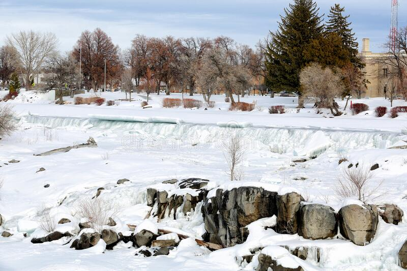 Ice on the waterfall that the City of Idaho Falls, Idaho is named after. The falls freezes on a cold winter day and ice sheets back up on the waterfall that the stock photography