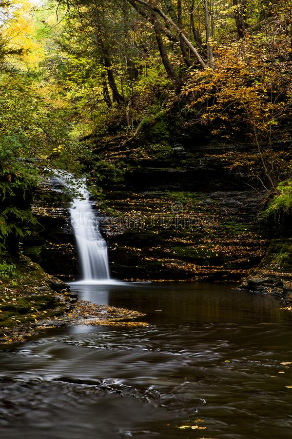 Falls of She-Qua-Ga Creek - Waterfall in Autumn - Montour Falls, New York. A scenic, autumn view of cascades along She-Qua-Ga Creek in Montour Falls, New York stock image