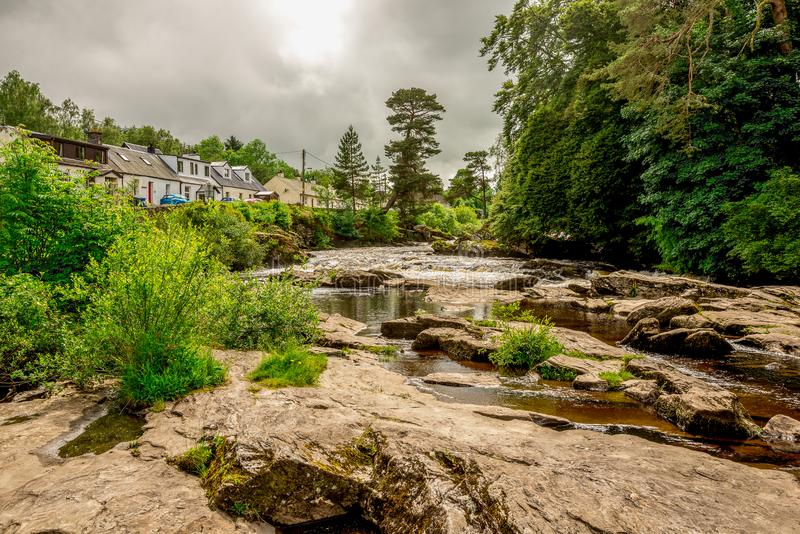 Falls of river Dochart in Loch Lomond and The Trossachs National Park at town of Killin, central Scotland stock images
