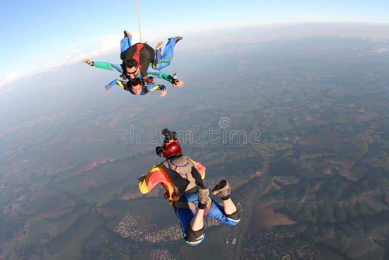 Fallskärmshopparefotografarbete royaltyfria foton
