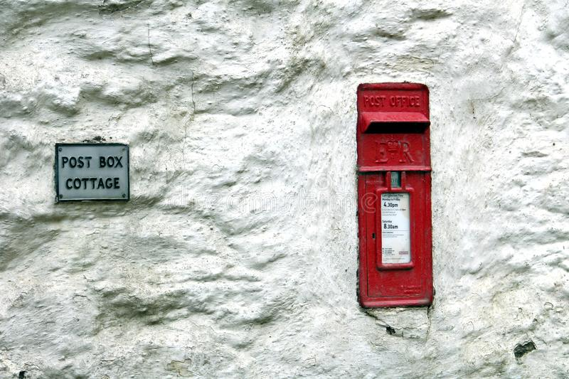 Falmouth, Cornwall, UK - April 12 2018: A traditional British Royal Mail Post Office post box, set into a rough rustic white wall stock photo